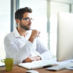 picture of a man looking at computer